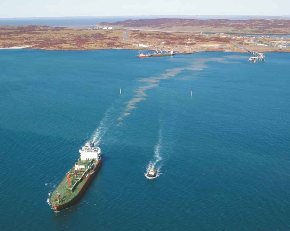 An aerial photo of a ship sailing away from the docks adjacent to the ammonia plant in Western Australia.  It is carrying liquified ammonia